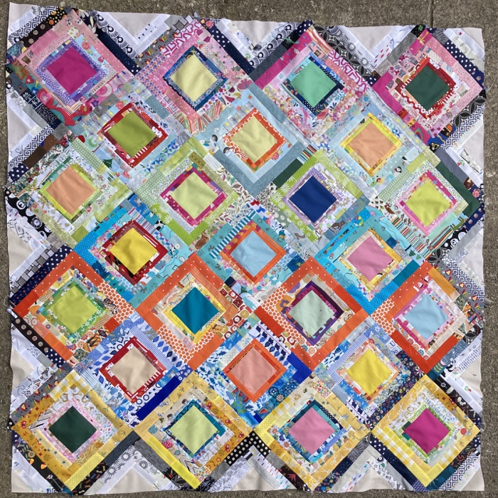 a colourful square quilt