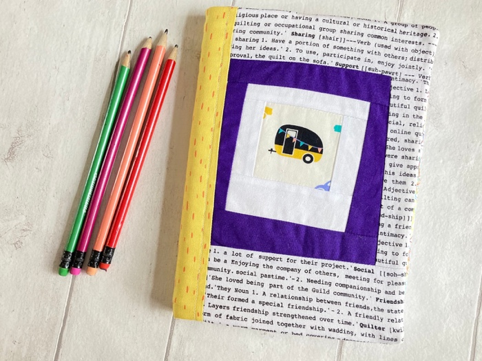 a cute caravan picture on a notebook with yellow binding