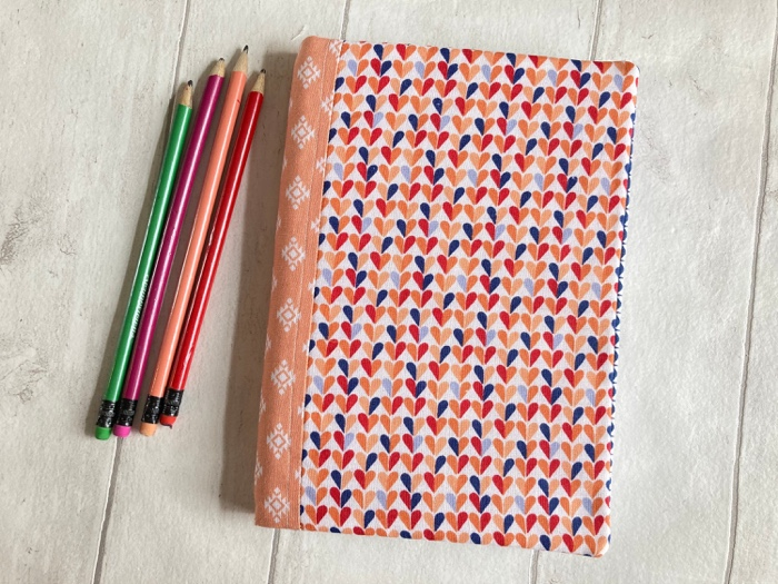 a orange lovehearts notebook cover