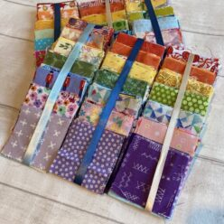"A set of 2.5"" Rainbow Charm scrap packs"