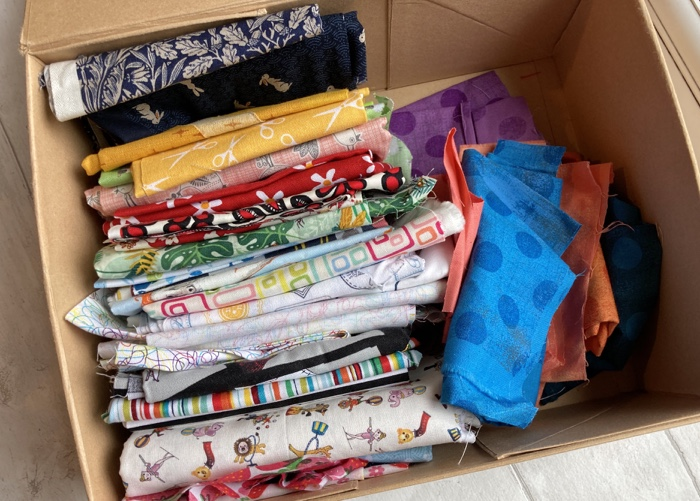 A box of folded up fabric