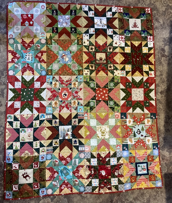 lots of stars and a truly scrapy looking red/goldgreen quilt top